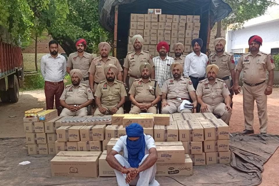 The accused and recovered items in police custody in Ludhiana on Friday