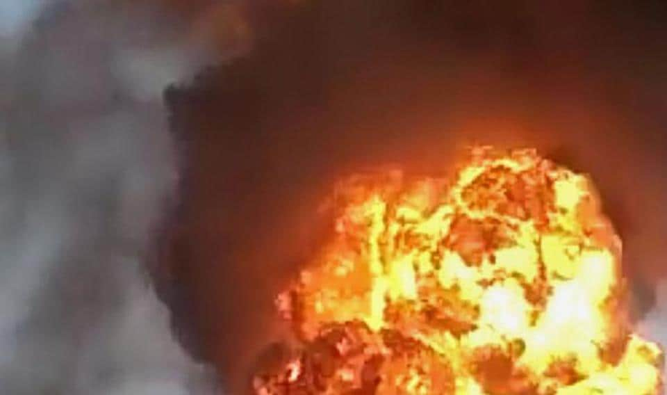 Fire rises out of a burning chemical factory after a cylinder explosion in Dhule, Saturday, Aug 31, 2019