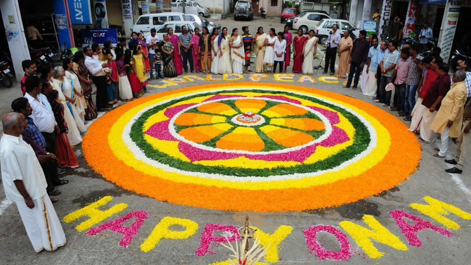 Malyali community of Mahabali Nagar decorated Bhopal`s biggest Pookkalam to welcome the emperor Mahabali ahead of Onam festival in Bhopal, India, on Sunday, August 23, 2015. (Photo by Mujeeb Faruqui/ Hindustan Times)