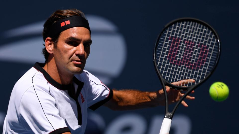 Federer crushes Goffin to reach last eight