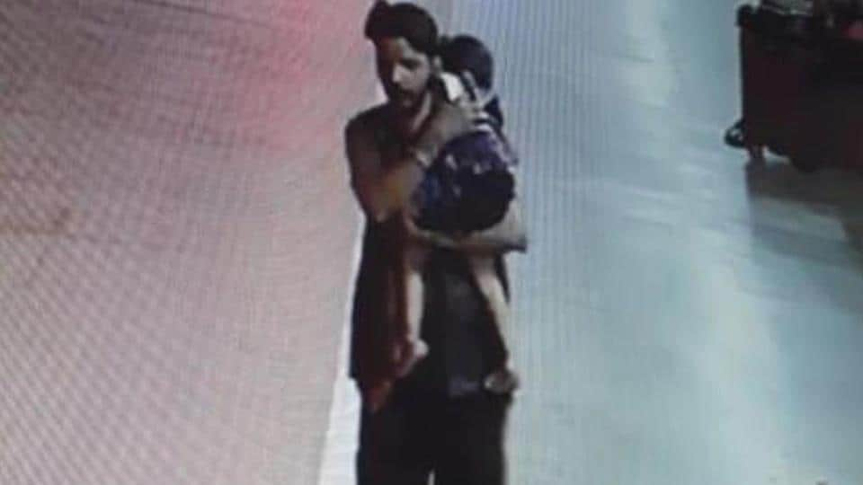 The three-year-old was sleeping with her mother at the railway station on July 25 when she was picked up by Rinku Sahu, seen here in CCTV footage, walking away with the sleeping girl in his arms.