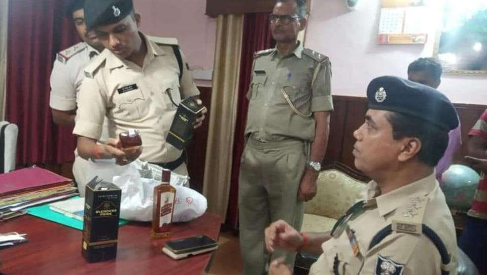 A police sub-inspector and three other policemen have been arrested and sent to jail for smuggling liquor following a tip-off from the rioting accused they were bringing from Varanasi.