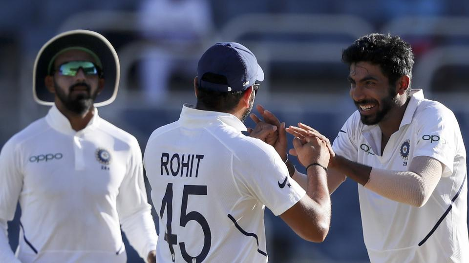 India's Jasprit Bumrah, right, celebrates with Rohit Sharma taking the wicket of West Indies' captain Jason Holder. (AP)