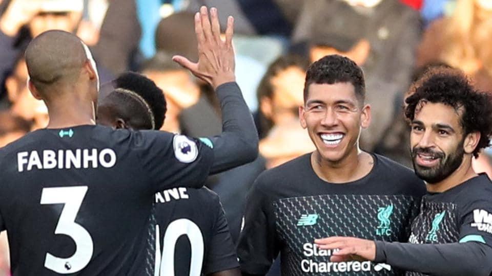 Liverpool's Roberto Firmino celebrates scoring their third goal.