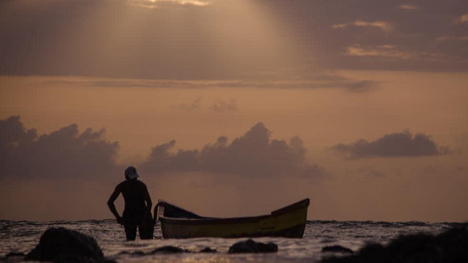 A fisherman anchors his boat after fishing at Carter road in Mumbai.