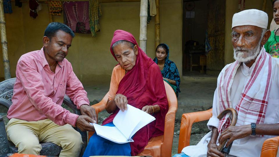 Khaibar Ali (43) along with his father Jahur Ali (73) and mother Sarifa Bebi (54) check the names in the recently published final list of the National Register of Citizens, Baska district, Assam, September 1, 2019