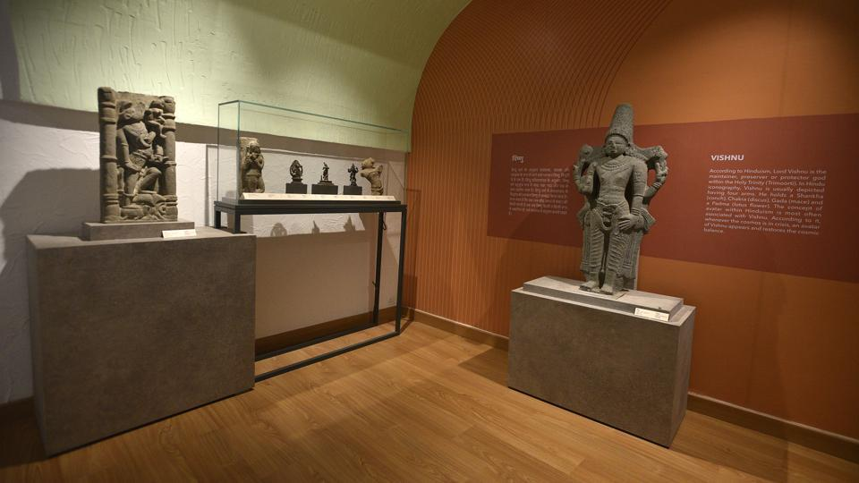 Artifacts on display in the gallery of confiscated and retrieved objects, inside the Purana Qila complex in New Delhi. The gallery, a first of its kind in the country, was inaugurated on Saturday by minister of state for culture Prahlad Singh Patel. It showcases various objects that have been recovered from art galleries across the world. A sculpture of Vishnu, the Hindu God who is considered the protector, can be seen on the right. (Biplov Bhuyan / HT Photo)