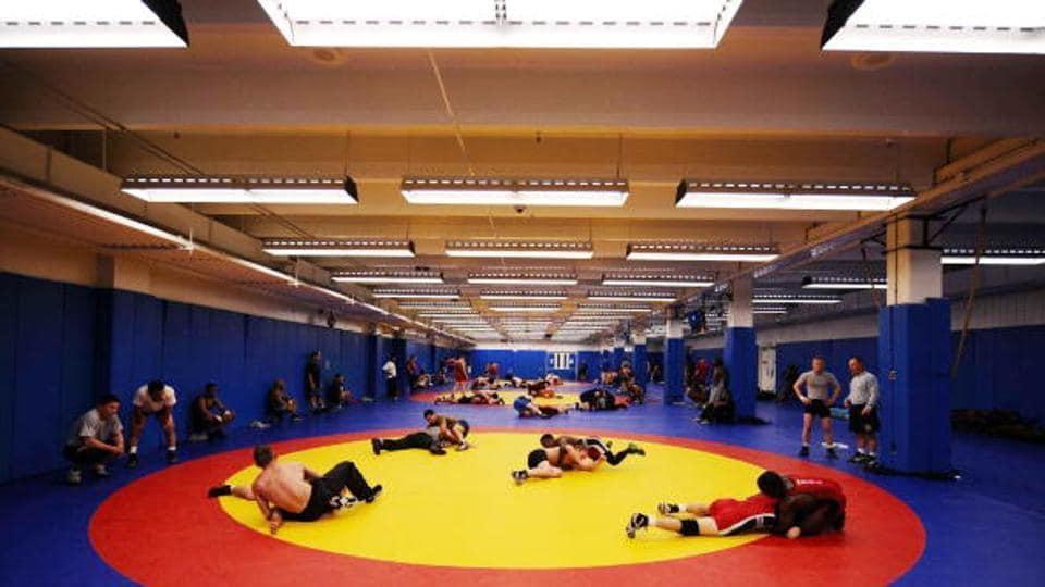 File photo of athletes wrestling.