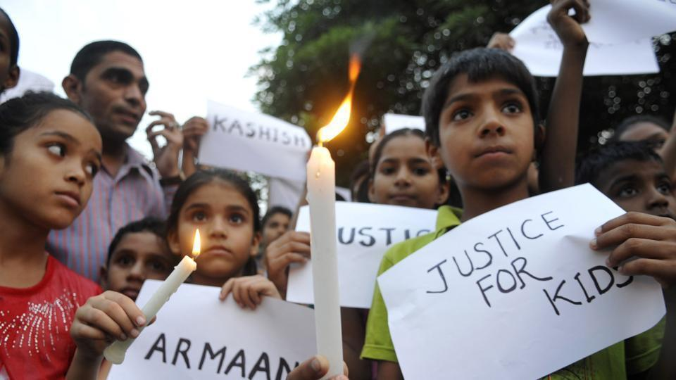 Children join a rally protesting against sexual crimes committed towards minors. In Gurugram, a 14-year old was sodomised by two men who also spiked his drink.