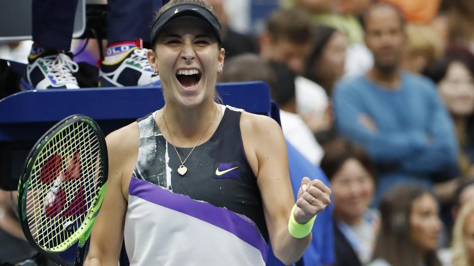 Belinda Bencic of Switzerland celebrates after her match against Naomi Osaka of Japan.