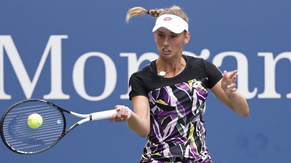 Elise Mertens of Belgium hits a forehand against Kristie Ahn of the United States.