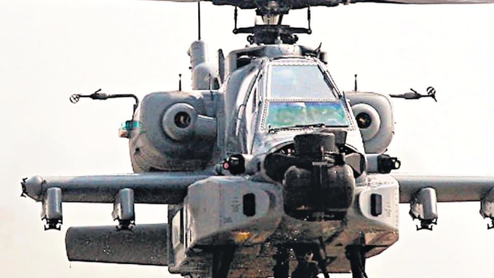 An IAF Apache chopper readies for takeoff.