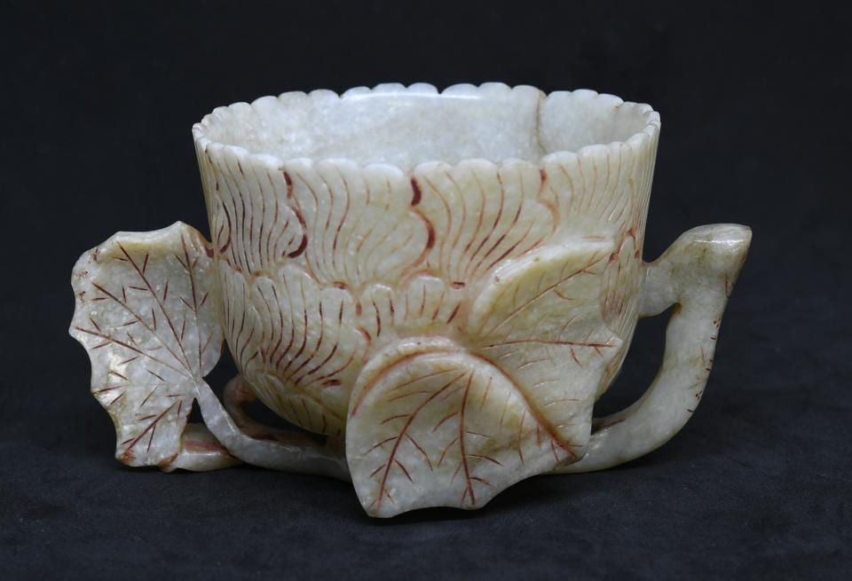 The wine bowl of Jahangir is made of white jade.
