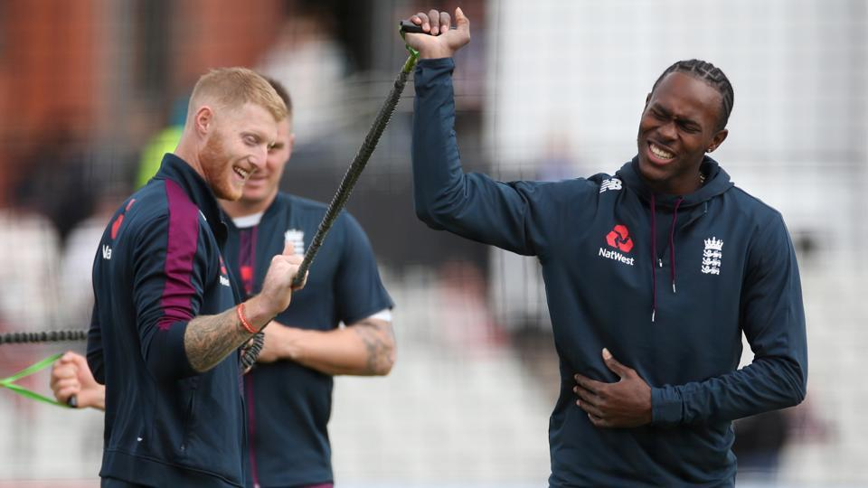 England's Jofra Archer warms up before play.
