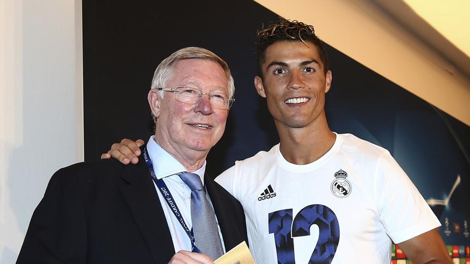 Real Madrid's Cristiano Ronaldo receives his man of the match award from Sir Alex Ferguson after the Champions League final soccer match between Juventus and Real Madrid at the Millennium stadium in Cardiff, Wales Saturday June 3, 2017. (AP Photo/Jan Kruger, UEFA via AP)