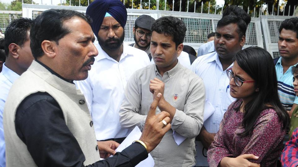 Panjab University's dean of student welfare (DSW) Emanual Nahar  interacting with students during a protests.