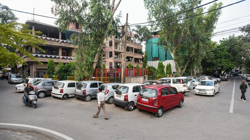 Cars parked in a residential parking area at C-block in Lajpat Nagar-2, New Delhi on Tuesday.