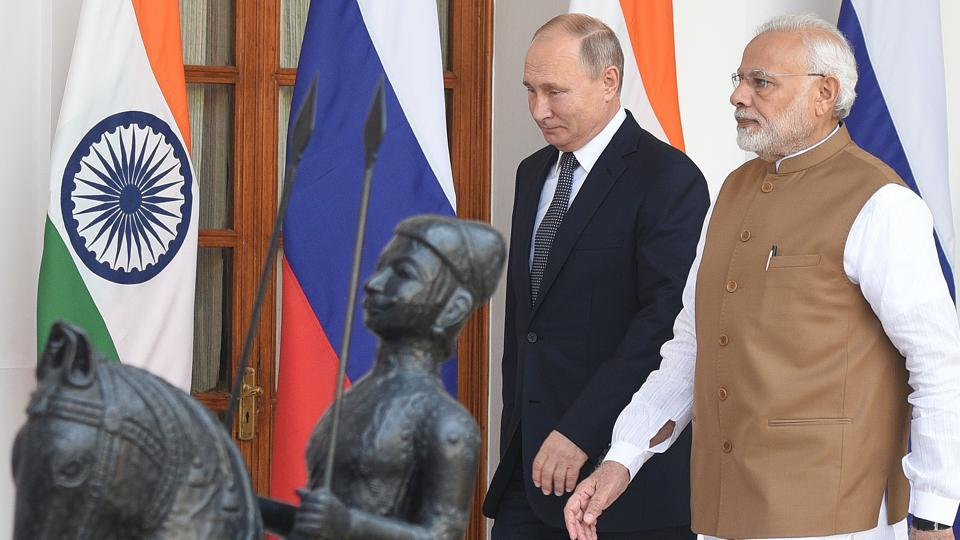Prime Minister Narendra Modi accompanied by President Vladimir Putin during the visit to the shipyard.