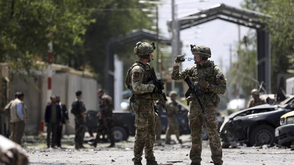 Resolute Support (RS) forces arrive at the site of car bomb explosion in Kabul, Afghanistan. A car bomb rocked the Afghan capital on Thursday and smoke rose from a part of eastern Kabul near a neighborhood housing the US Embassy, the NATO Resolute Support mission and other diplomatic missions.