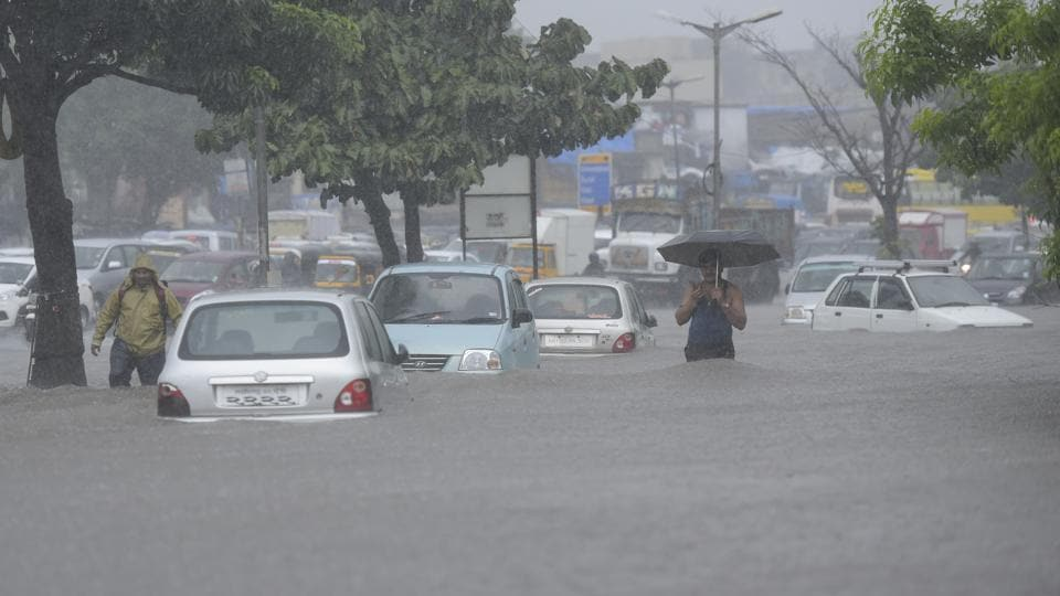 Water logging due to heavy rain on Western express highway Santacruz east Agri pada in Mumbai, India, on Wednesday.
