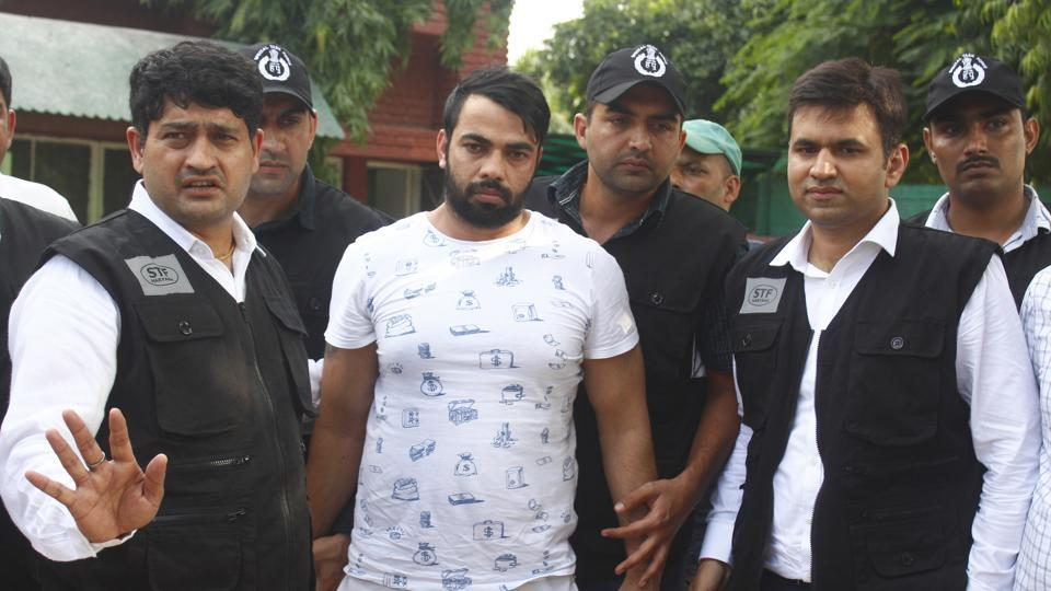 The Special Task Force (STF) Haryana police with gangster Kaushal who was arrested from Indira Gandhi International Airport early morning, at Police Commissioner Office in Faridabad.