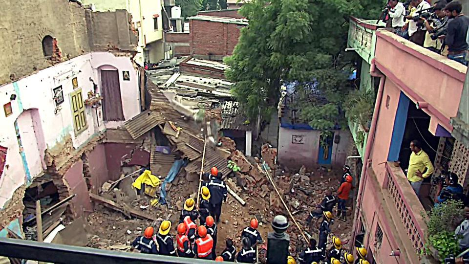 Rescue operations underway after a three-storey building collapses at the Amraiwadi area in Ahmedabad on Thursday.