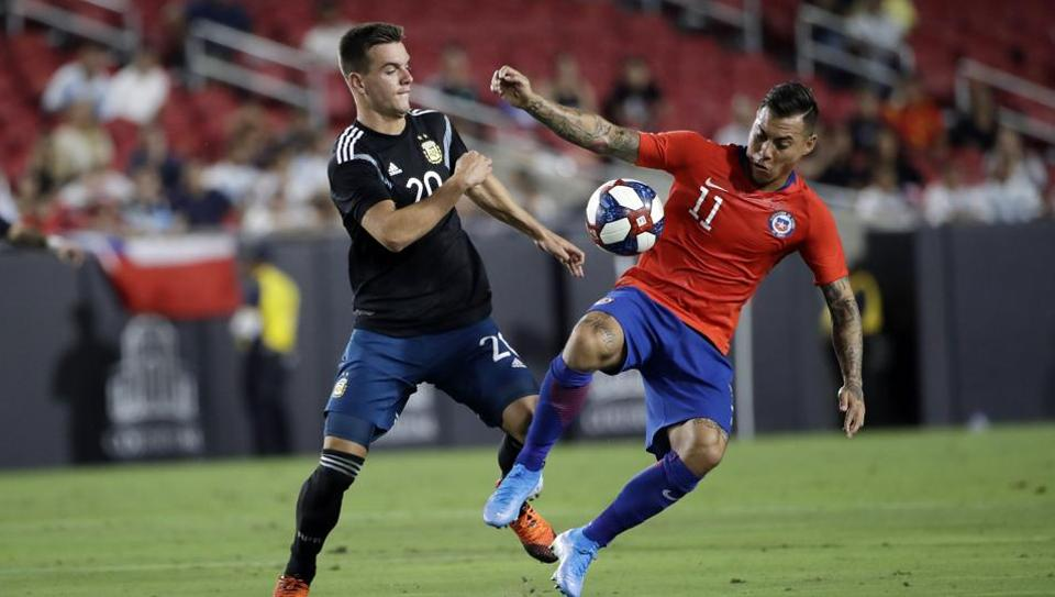 Chile's Eduardo Vargas, right, is defended by Argentina's Giovani Lo Celso in an international friendly in Los Angeles.