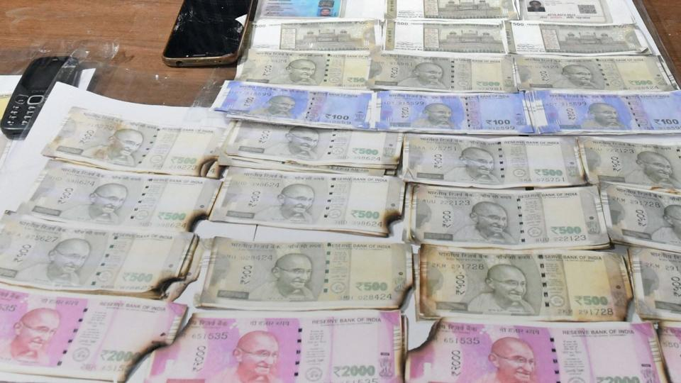 A supplementary charge sheet has been filed against an accused in the Rs 6.34 lakh Fake Indian Currency Note (FICN) case here in Bengaluru. In this file picture, Special Task Force of Madhya Pradesh Police arrest three persons and seize fake currency notes from Indore.