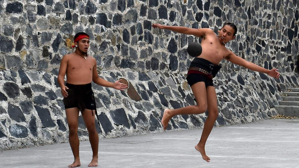 Wearing their traditional belts and loincloths, his players hit the nearly four-kilogram rubber ball with their hips, trying to send it through a vertical stone ring six meters (20 feet) high. The game is played by teams of one to seven players. Centuries ago, they were all men. But here, the game is open to women, too. (Rocio Vazquez / AFP)