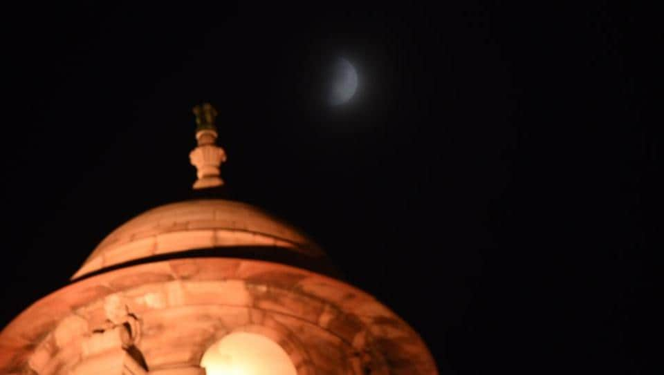 A view of the half moon in the night sky seen from Rajpath in New Delhi on Friday. The Chandrayaan-2 lunar mission  will soft-land on the surface of the moon with the Vikram rover tonight.
