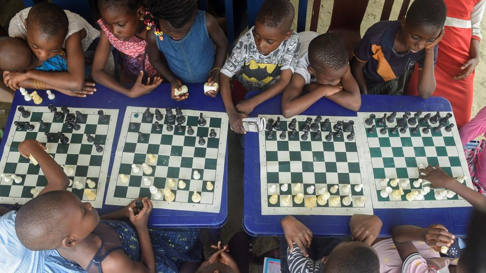 Children sit under a canopy as they play during a chess class at Ogolonto in Ikorodu district of Lagos. Chess -- a board game famous for its reliance on strategy -- has a tiny but avid following in Nigeria. The West African nation ranks 88th out of 186 countries, according to the FIDE World Chess Federation's rating of top players across the globe, but still does not have any Grandmasters. (Pius Utomi Ekpei/ AFP)