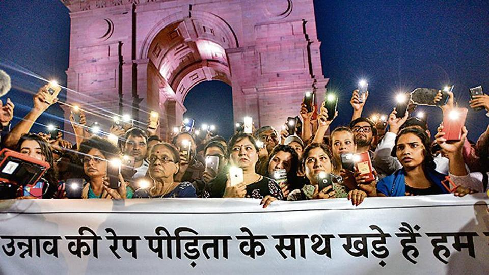 People protest in front of India Gate for the Unnao rape victim in New Delhi on July 29, 2019.
