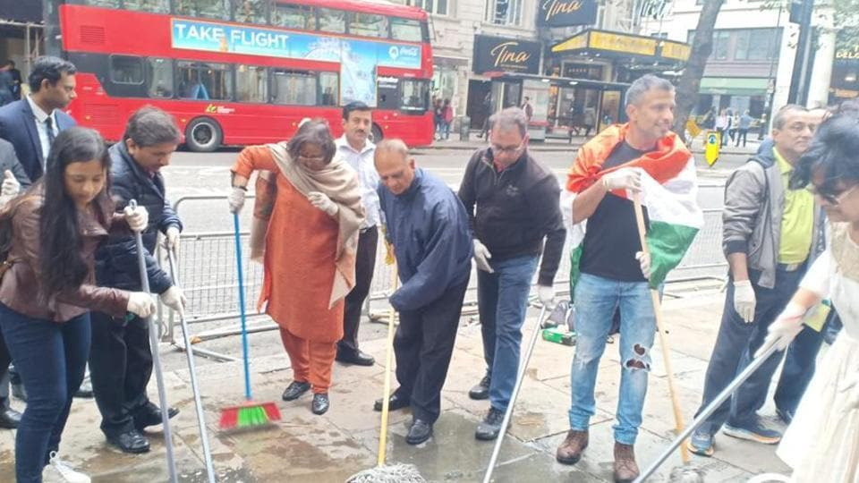 Indian HCto the UK, takes up a cleaning drive with other Indians living in the UK outside India House, London.