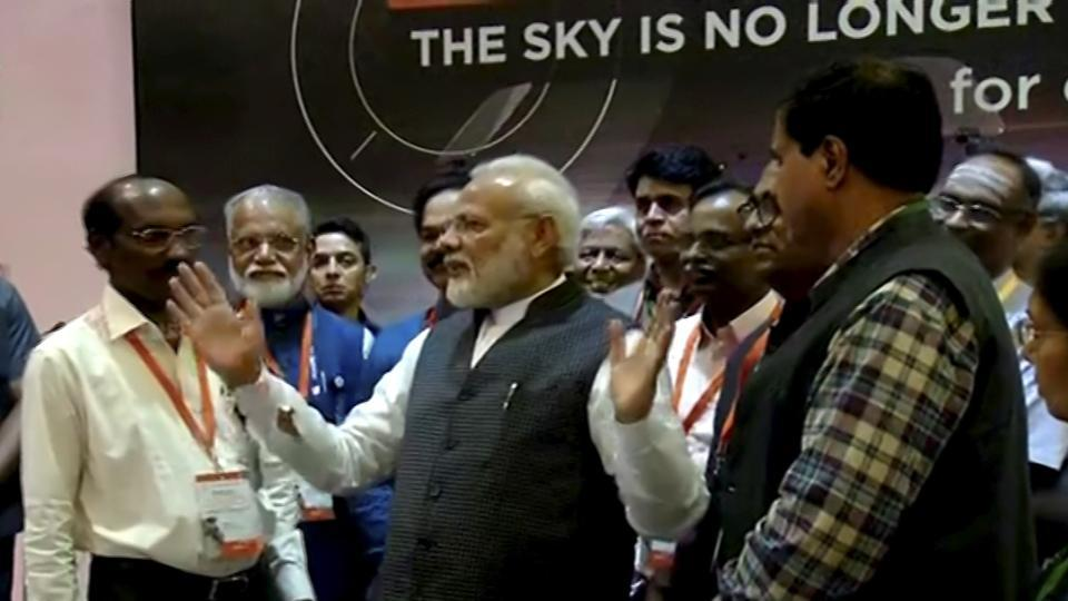 **EDS: VIDEO GRAB** Bengaluru: Prime Minister Narendra Modi interacts with ISRO Chairman Kailasavadivoo Sivan after connection with the Vikram lander was lost during soft landing of Chandrayaan 2 on lunar surface, in Bengaluru, Saturday, Sept. 7, 2019. (PTI Photo)(PTI9_7_2019_000016B)