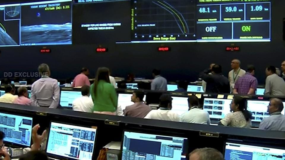 Officials watch live telecast of the soft landing of Vikram module of Chandrayaan 2 on lunar surface as it starts 'fine breaking' at ISRO Telemetry Tracking and Command Network (ISTRAC), in Bengaluru, Saturday, Sept. 7, 2019.
