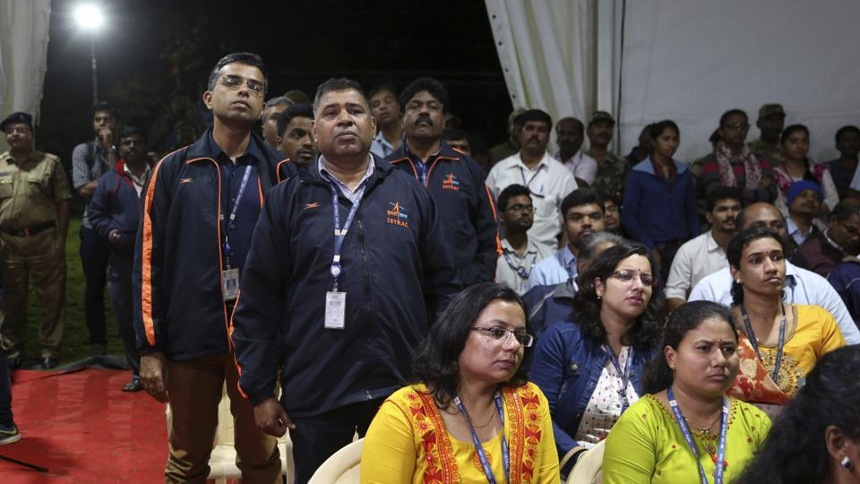 Indian Space Research Organization (ISRO) employees react as they listen to an announcement by organizations's chief Kailasavadivoo Sivan at its Telemetry, Tracking and Command Network facility in Bengaluru on Saturday. Isro lost touch with its Vikram lunar lander as it aimed to land on the south pole of the moon and deploy a rover to search for signs of water.