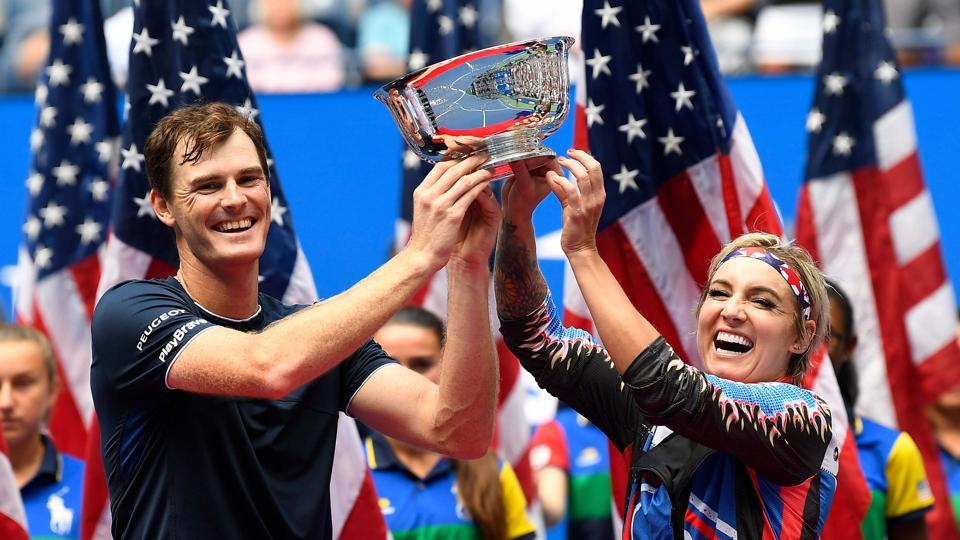 Bethanie Mattek-Sands and Jamie Murray with the US Open trophy.