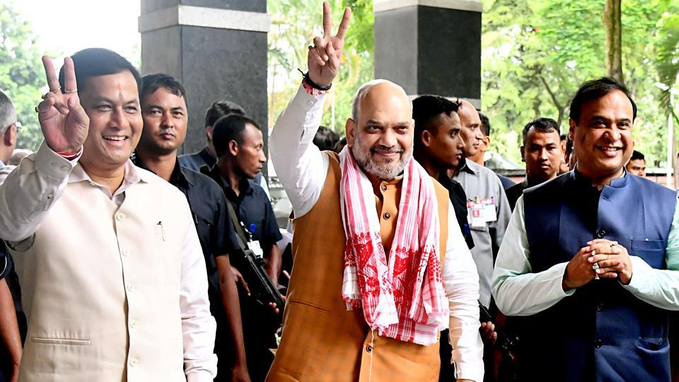 Union Home Minister Amit Shah and Assam Chief Minister Sarbananda Sonowal show victory sign as Finance Minister of Assam Dr. Himanta Biswa looks on (R) during their arrival to attend the two days long 68th Plenary session of the North Eastern Council (NEC) at Assam Administrative Staff College, Khanapara in Guwahati on Sunday. (ANI Photo)