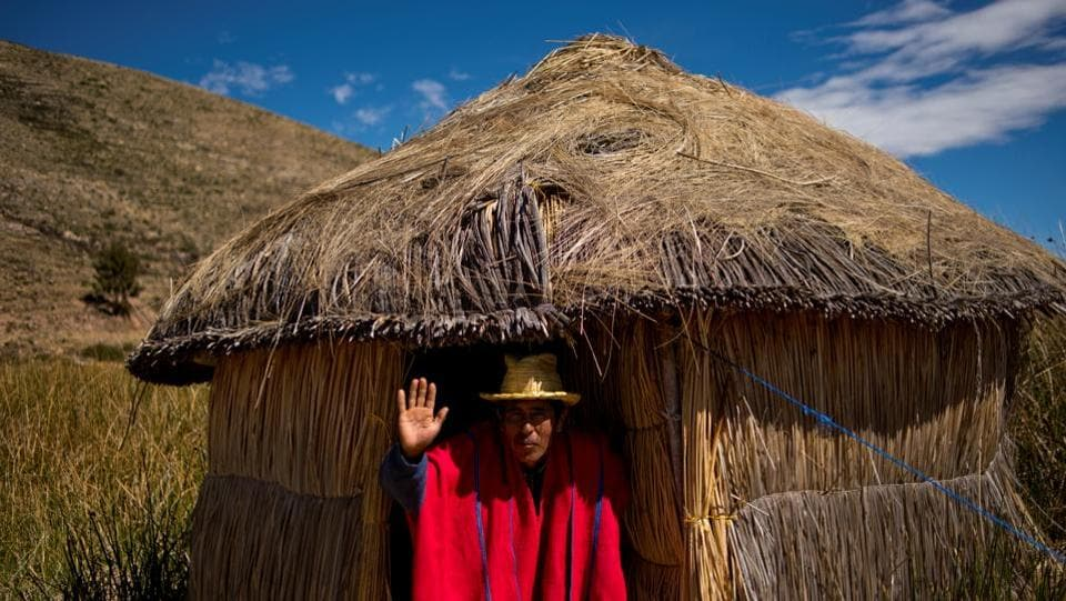 """Oscar Limachi, 48, a member of the local Qewaya community who works as a tour guide on Lake Titicaca, in Qewaya village, Bolivia. Limachi said that waste and a lack of understanding about pollution risk changing the habitat forever. """"It is also our fault, people throw garbage and plastic everywhere, they don't understand this is polluting,"""" he said. (Manuel Seoane / REUTERS)"""