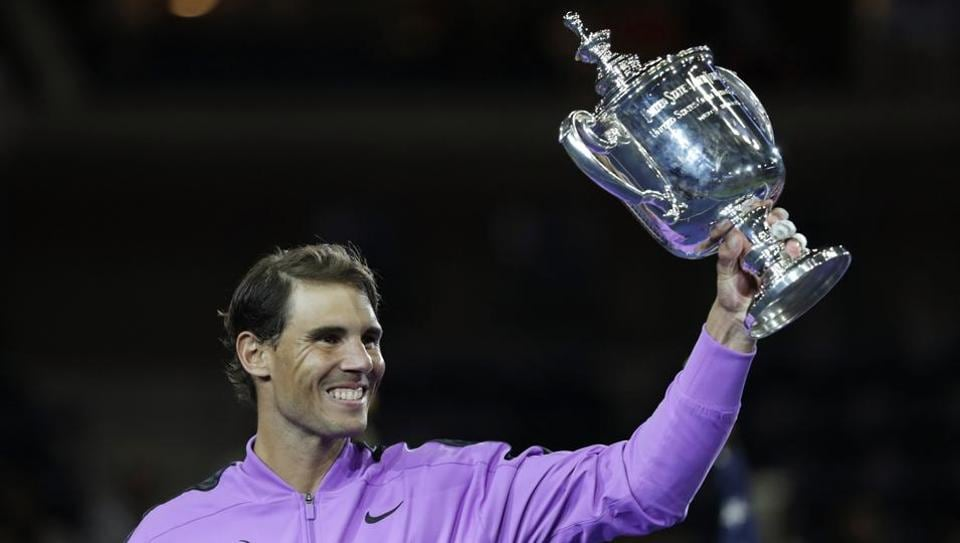 Rafael Nadal, of Spain, holds up the championship trophy after defeating Daniil Medvedev, of Russia, to win the men's singles final of the U.S. Open tennis championships Sunday, Sept. 8, 2019, in New York.