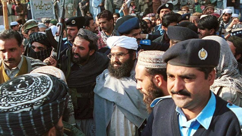 In this Jan. 27, 2000 file photo, Masood Azhar, center, (wearing glasses and white turban), leader of Jaish-e-Mohammad arrives in Islamabad, Pakistan.