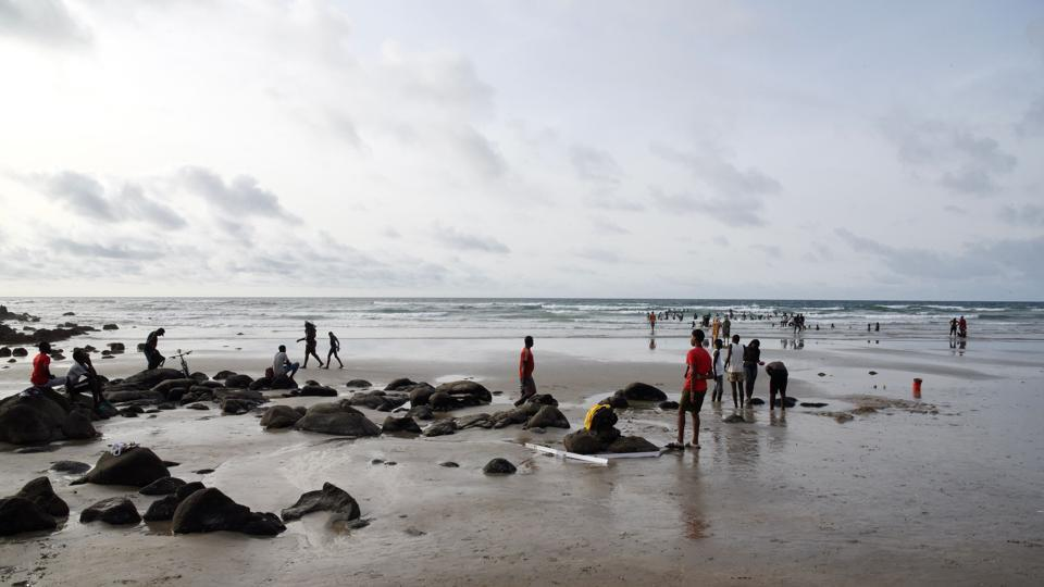 People walk on Yoff Virage beach, facing the Copacabana restaurant. Thiaw also regularly organises teams to clean up rubbish, but there is not one sorting centre for household waste in all of Senegal. (Seyllou / AFP)