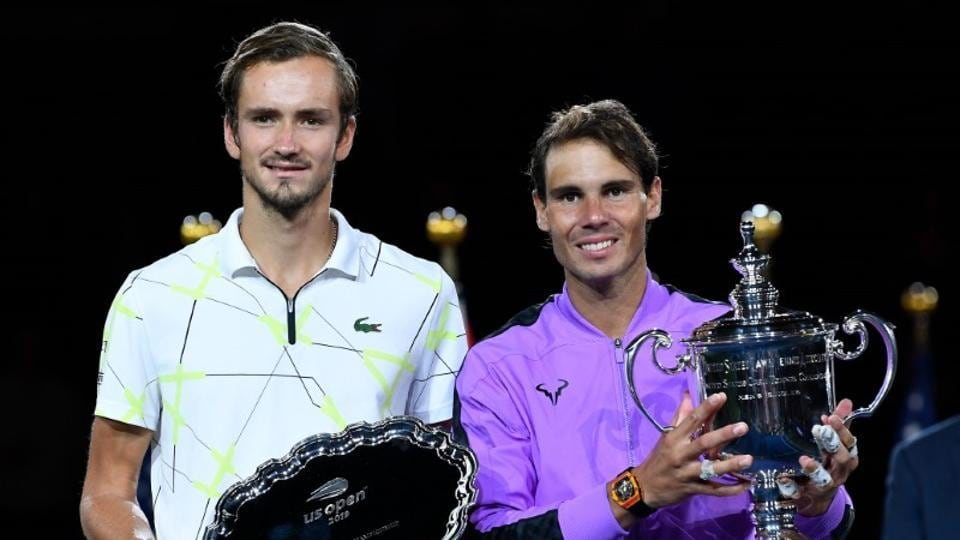 Rafael Nadal of Spain (right) and Daniil Medvedev of Russia pose with their trophies after the men's singles final
