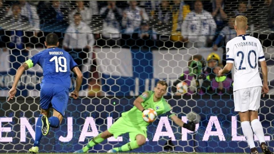 Goalkeeper Lukas Hradecy fails to stop the penalty by Italy's Jorginho.