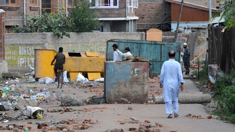 """""""India says it wanted to integrate Kashmir but it is an ugly country. You are a sham democracy,'' says a young man on a street in a South Kashmir village."""