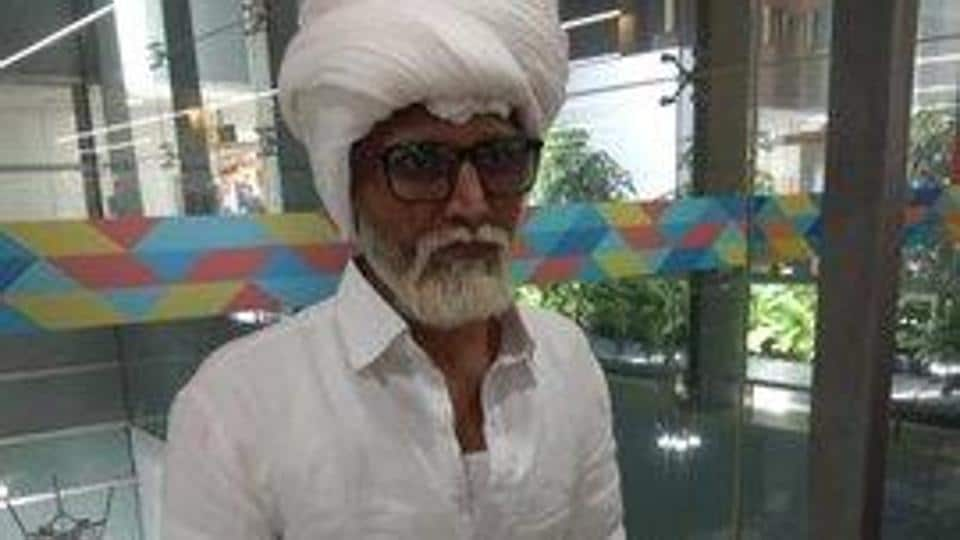 Jayesh Patel, a resident of Ahmedabad, coloured his hair and beard white, arrived on a wheelchair to board a flight to New York from the Indira Gandhi International Airport on Sunday, they said.