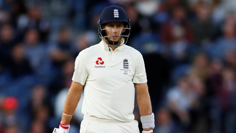 England's Joe Root walks after losing his wicket.