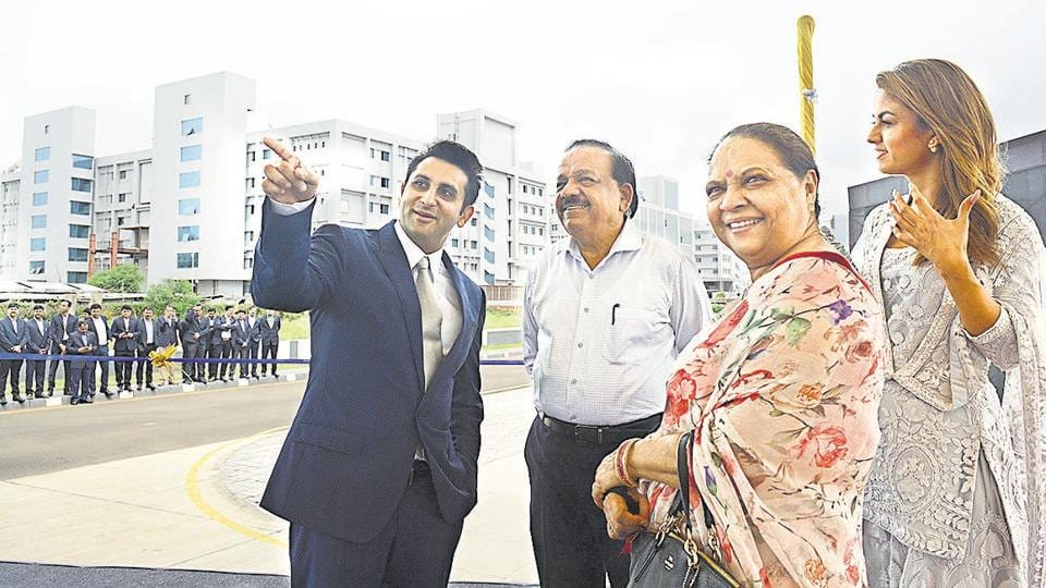 Serum Institute CEO Adar Poonawalla (left) and Natasha Poonawalla (right), executive director of the institute, with Harsh Vardhan, Union minister for health, and Nutan Vardhan (foreground), his wife, at the launch of a manufacturing unit of Serum Institute of India in Pune on Monday.