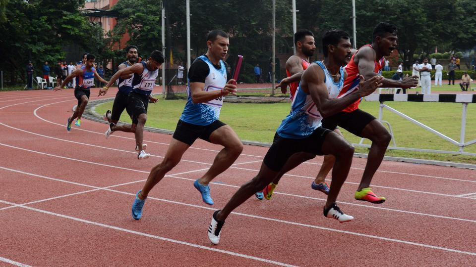Athletes taking part in a relay race during the 69th Inter-Services Athletics Championship at the Army Sports Institute in Pune  on Monday.