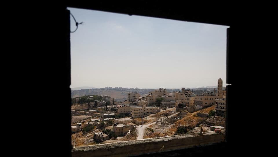 A view shows Palestinian houses in al-Eizariya village, close to the Jewish settlement of Maale Adumim, in the Israeli-occupied West Bank. Israel's settlements in the occupied West Bank are one of the most heated issues in the Israeli-Palestinian conflict. The Palestinians want the area, captured by Israel in a 1967 war, for a future state. (Raneen Sawafta / REUTERS)